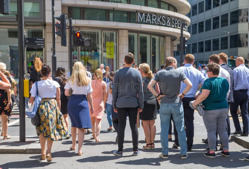 London, UK Business people and office workers walking next to Lloyds building in the City of London during lunch time stock photo