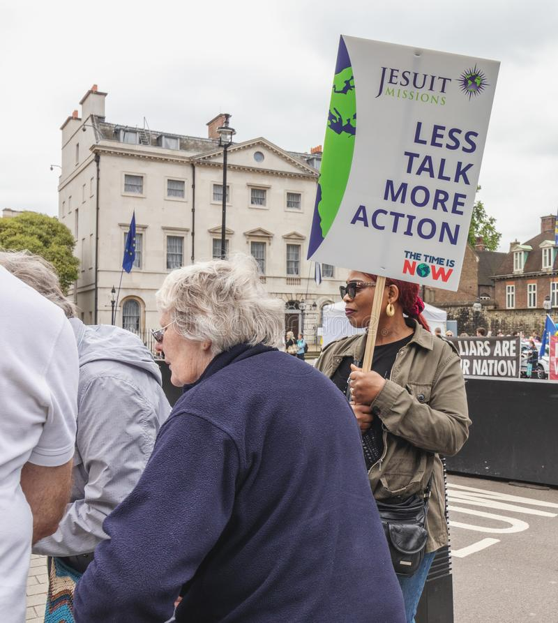 London / UK - June 26th 2019 - Woman holding climate change sign outside Parliament as part of a Time Is Now climate change event stock photo