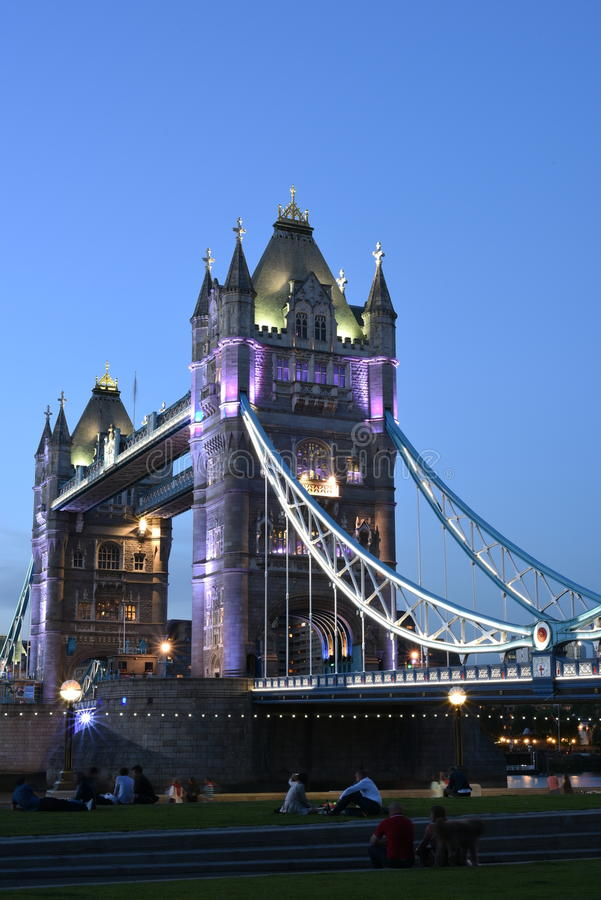 London UK, Majestic Tower Bridge at night with light trails of bus and cars, artistic long exposure night shot stock images