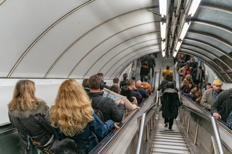 London, UK - 05, March 2019: The Bank station in London Underground, people use escalator at rush hour royalty free stock photo