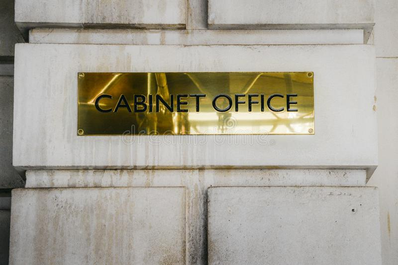Cabinet Office brass plaque in Whitehall London government office stock photography