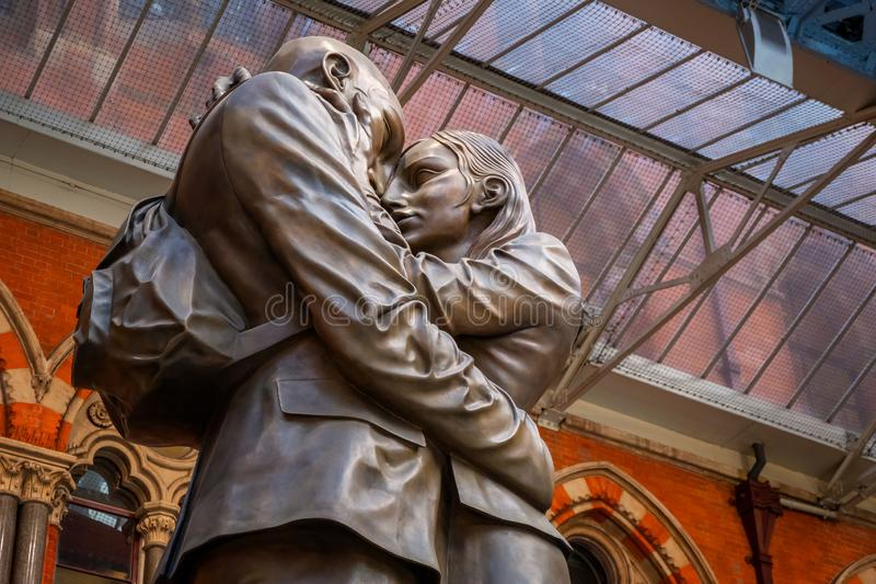 The Meeting Place bronze statue at St. Pancras Station in London, UK stock photo