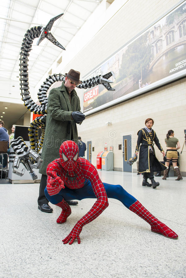 LONDON, UK - May 26: Spiderman and Doctor Octopus cosplayers posing at the MCMExpo at the Excel Centre. May 26, 2013 in London. stock images