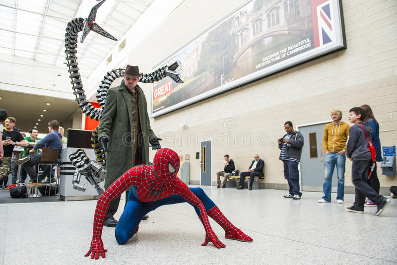 LONDON, UK - May 26: Spiderman and Doctor Octopus cosplayers posing at the MCMExpo at the Excel Centre. May 26, 2013 in London. royalty free stock photos