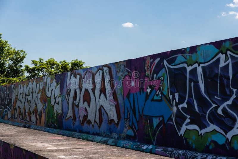 LONDON, UK - MAY 21, 2019 street art paintings panorama on the wall in the park in London, a wall where street artists can present stock illustration
