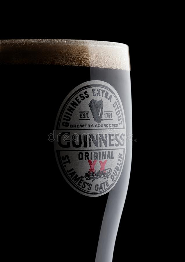 Free LONDON, UK - NOVEMBER 10, 2017: Glass Of Guinness Original Beer On Black. Guinness Beer Has Been Produced Since 1759 In Dublin, Ir Stock Image - 103672341