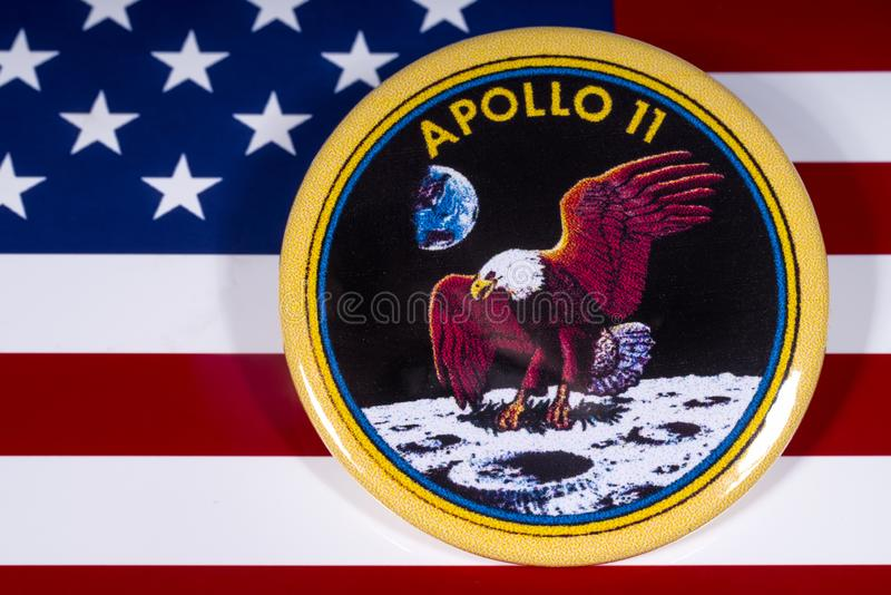Apollo 11 Badge and the USA Flag. London, UK - November 15th 2018: The badge of the historic Apollo 11 moon landing, pictured over the flag of the United States stock photos