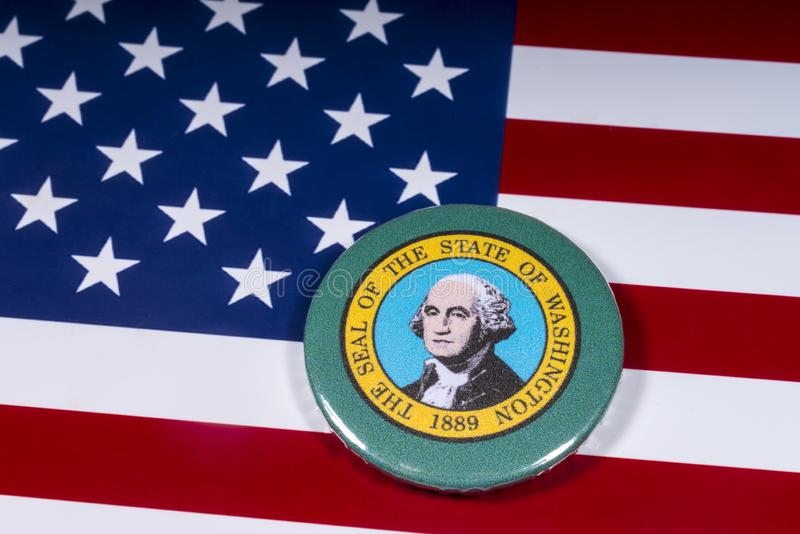 The State of Washington. London, UK - November 15th 2018: A badge portraying the seal of the State of Washington, pictured over the flag of the United States of royalty free stock photo