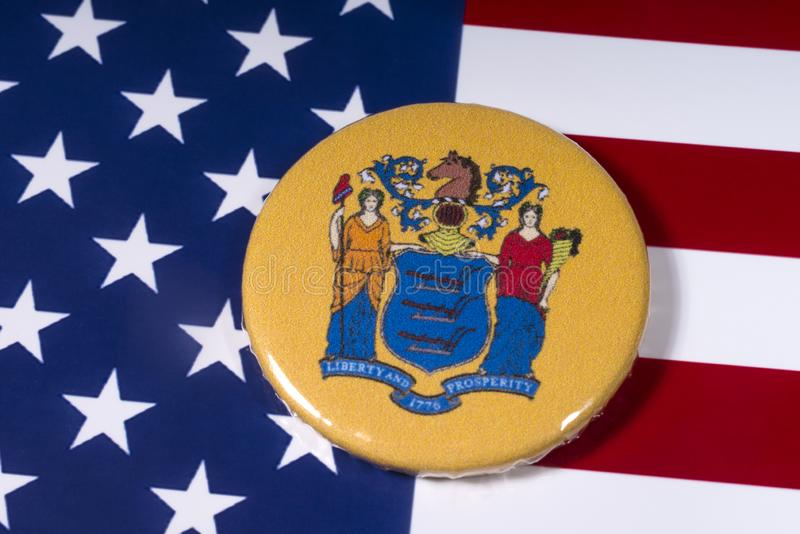 The State of New Jersey in the USA. London, UK - November 15th 2018: The coat of arms of the State of New Jersey, pictured over the flag of the United States of stock photos