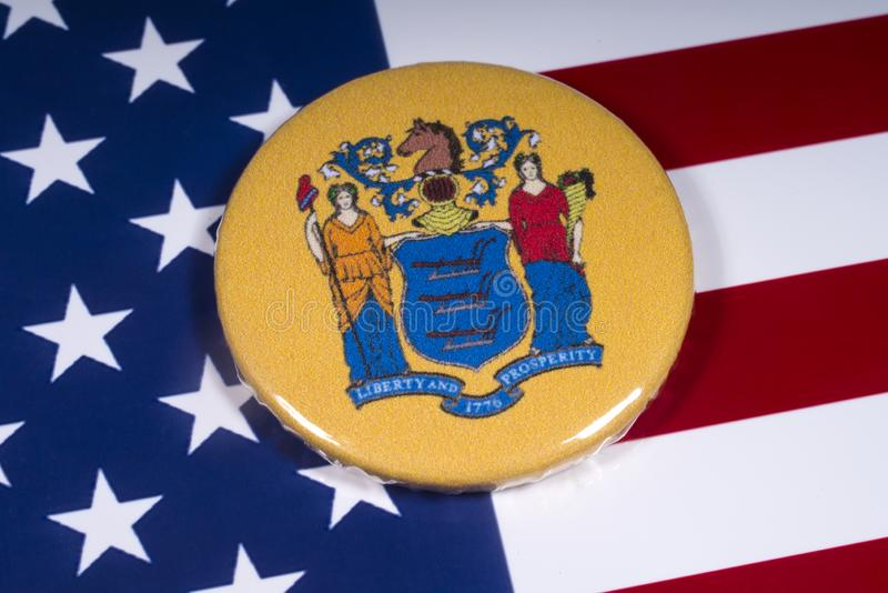 The State of New Jersey in the USA. London, UK - November 15th 2018: The coat of arms of the State of New Jersey, pictured over the flag of the United States of royalty free stock image