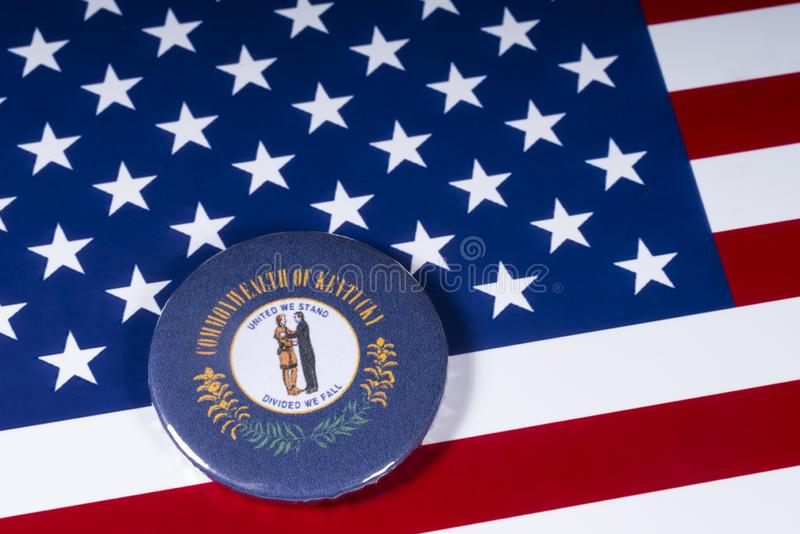 The State of Kentucky in the USA. London, UK - November 20th 2018: The symbol of the State of Kentucky, pictured over the flag of the United States of America royalty free stock image