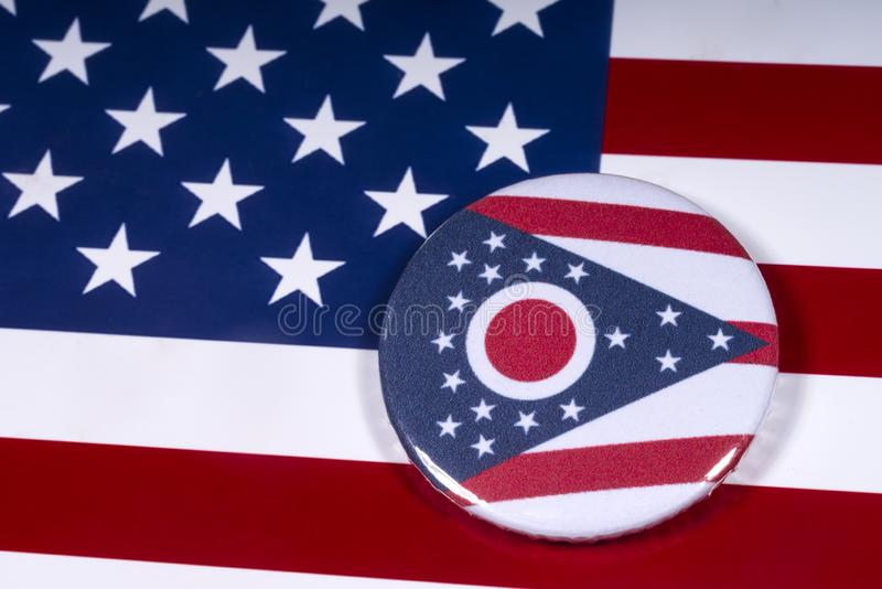 The State of Ohio in the USA. London, UK - November 15th 2018: The symbol of the State of Ohio, pictured over the flag of the United States of America royalty free stock photography