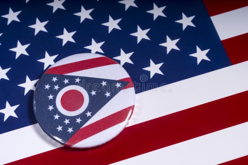 The State of Ohio in the USA. London, UK - November 15th 2018: The symbol of the State of Ohio, pictured over the flag of the United States of America stock photography