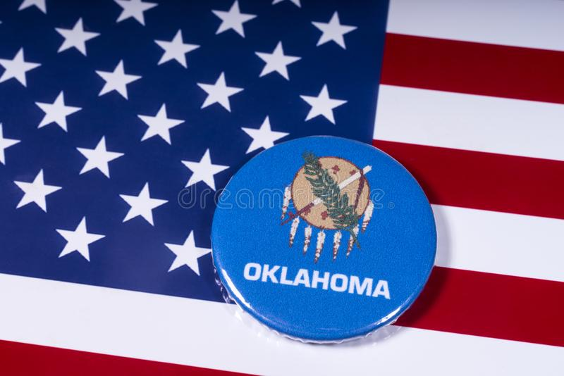 State of Oklahoma in the USA. London, UK - November 15th 2018: The symbol of the state of Oklahoma, pictured over the flag of the United States of America stock photos