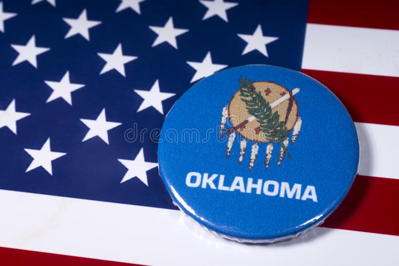 State of Oklahoma in the USA. London, UK - November 15th 2018: The symbol of the state of Oklahoma, pictured over the flag of the United States of America royalty free stock photos