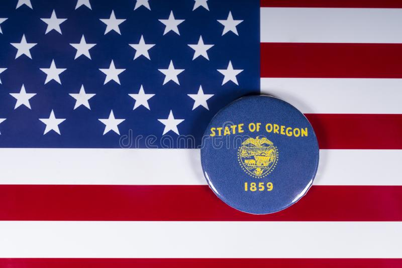 The State of Oregon in the USA. London, UK - November 20th 2018: The symbol of the State of Oregon, pictured over the flag of the United States of America royalty free stock photography