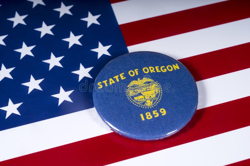 The State of Oregon in the USA. London, UK - November 20th 2018: The symbol of the State of Oregon, pictured over the flag of the United States of America stock photo
