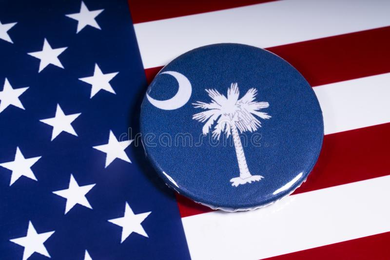 The State of Carolina. London, UK - November 15th 2018: The symbol of the State of South Carolina, pictured over the flag of the United States of America stock photos