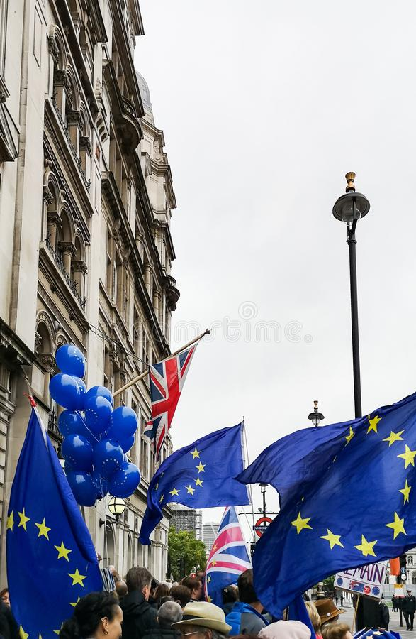 Anti-Brexit protest in London near Parliament. London, UK - 14 October, 2019: Anti-Brexit protest in London near Parliament. European Union and British Union stock images