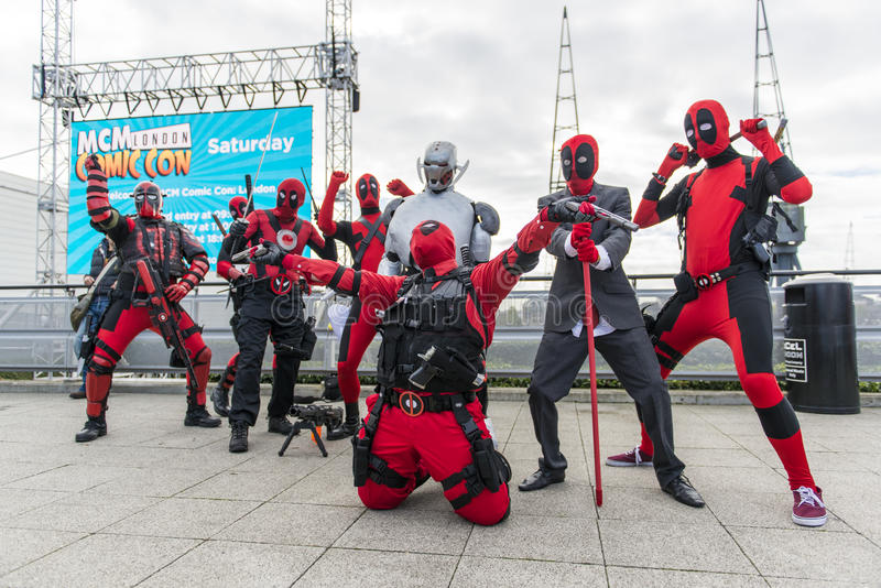 LONDON, UK - OCTOBER 26: Cosplayers dressed as Deadpool from the stock images