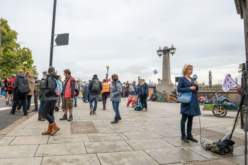 London, UK - October 7, 2019: Extinction Rebellion protest rally participants near Lambert Bridge stock images