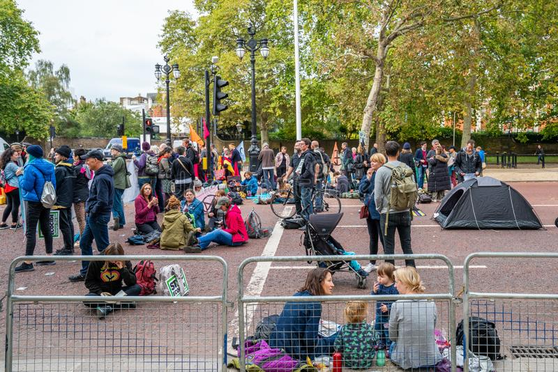 London, UK - October 7, 2019: Extinction Rebellion protesters block traffic on city streets royalty free stock images