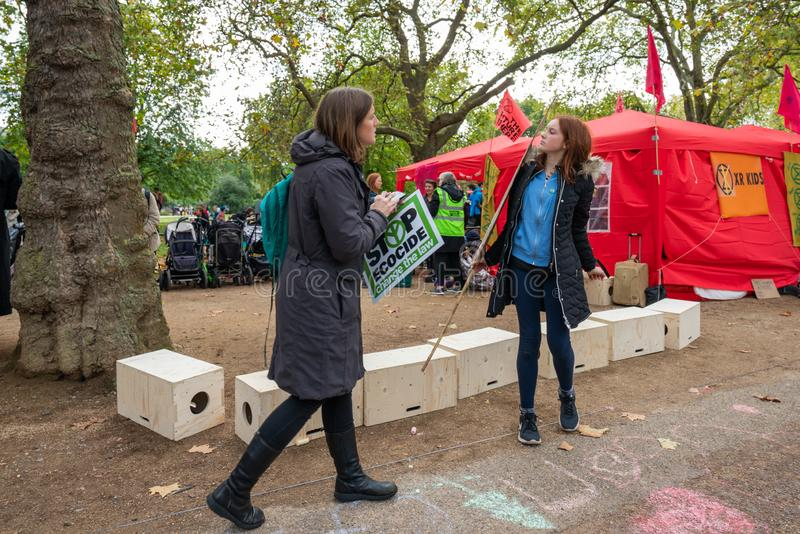 London, UK - October 7, 2019: Extinction Rebellion protesters block traffic on city streets royalty free stock photo