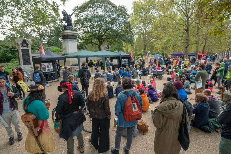 London, UK - October 7, 2019: Extinction Rebellion protesters block traffic on city streets royalty free stock photography