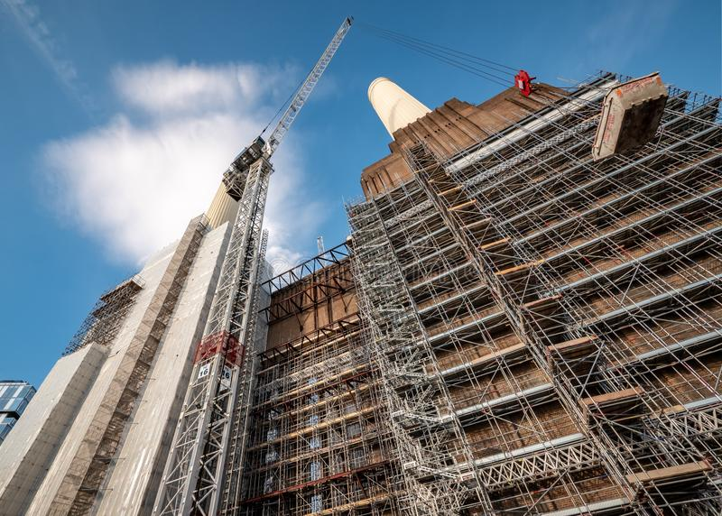 Battersea Power Station redevelopment, London. LONDON, UK - 31 OCTOBER 2018: A low angle view of the scaffolding, cranes and construction works being carried out royalty free stock photos