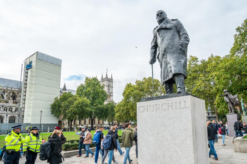 London, UK - October 7, 2019: Parliament Square Garden, Sir Winston Churchill Statue. Participants of the protest rally Extinction Rebellion stock images