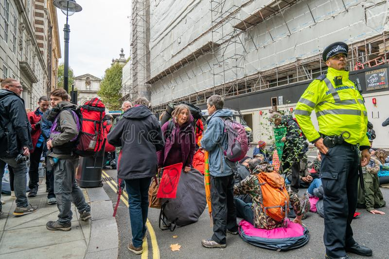 London, UK - October 7, 2019: Participants of the protest rally Extinction Rebellion royalty free stock photos