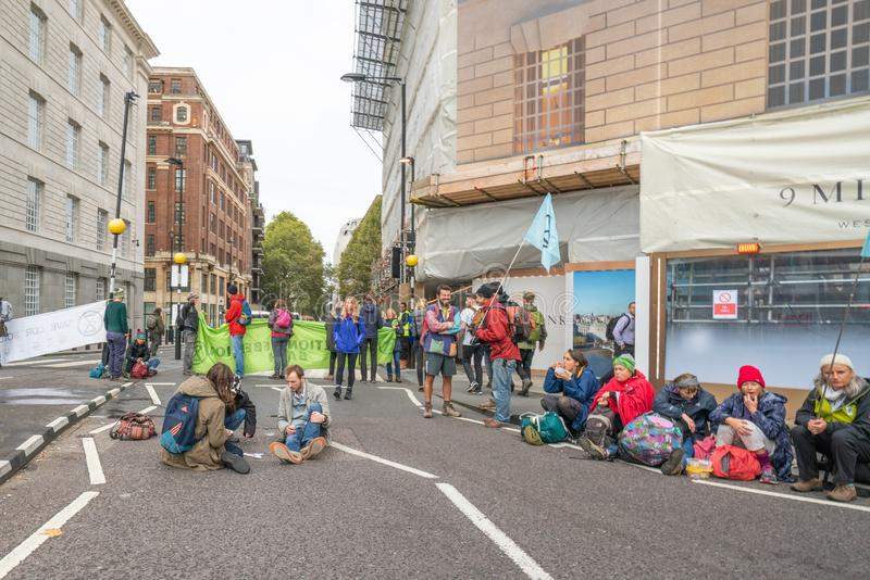 London, UK - October 7, 2019: Extinction Rebellion protesters block city streets royalty free stock image