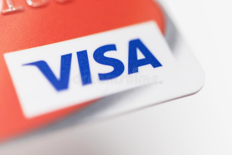 London / UK - October 9th 2019 - VISA logo on red bank card, closeup macro view with a shallow depth of field.  stock image