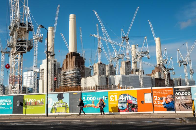 Battersea Power Station redevelopment, London. LONDON, UK - 31 OCTOBER 2018: Redevelopment work to Battersea Power Station. Hoarding illustrates the effects of royalty free stock photo