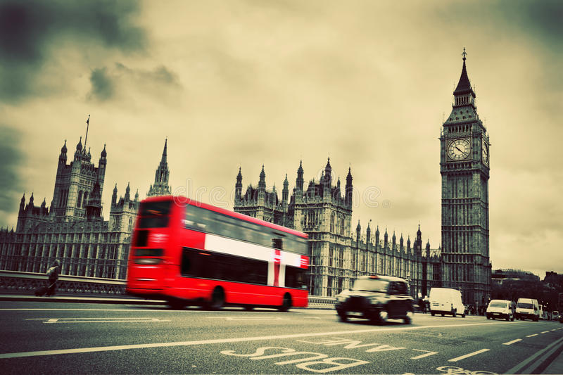 London, the UK. Red bus, Big Ben. London, the UK. Red bus in motion and Big Ben, the Palace of Westminster. The icons of England in vintage, retro style stock photos