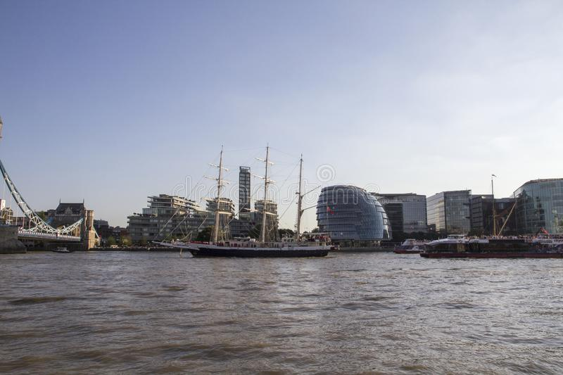 The Lord Nelson tall ship heading for Tower Bridge on the River Thames. London, England, UK, stock photos