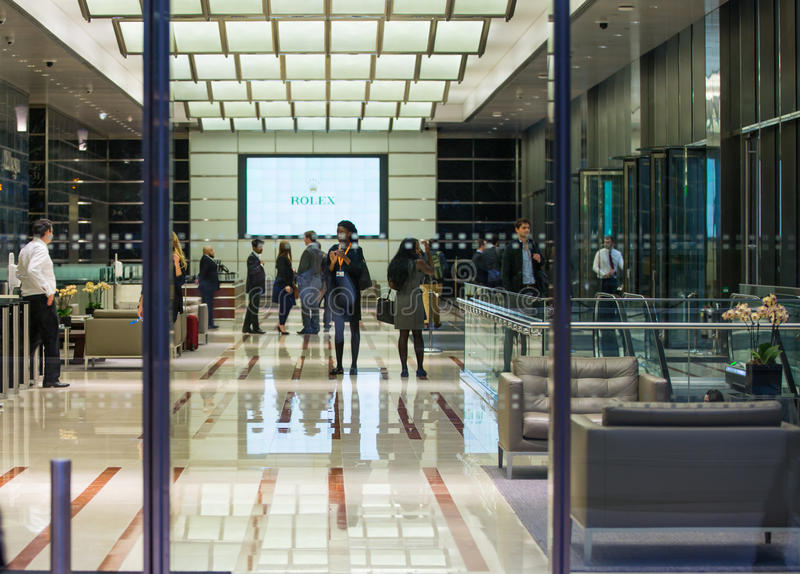 LONDON, UK - 7 SEPTEMBER, 2015: Office building entrance in night light. Canary Wharf night life stock images