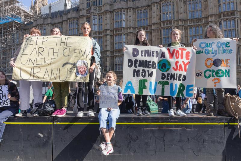 London / UK - September 20th 2019 - Female activists hold signs at the Climate Strike outside parliament in Westminster royalty free stock photography