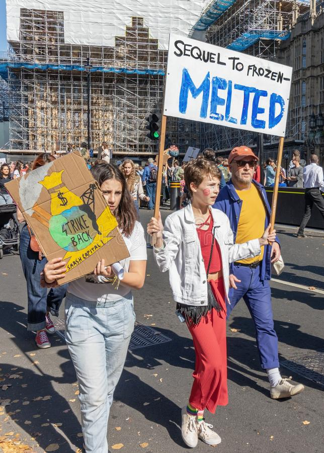 London / UK - September 20th 2019 - Young climate change activist hold signs saying Sequel To Frozen, Melted, and Strike Back stock images