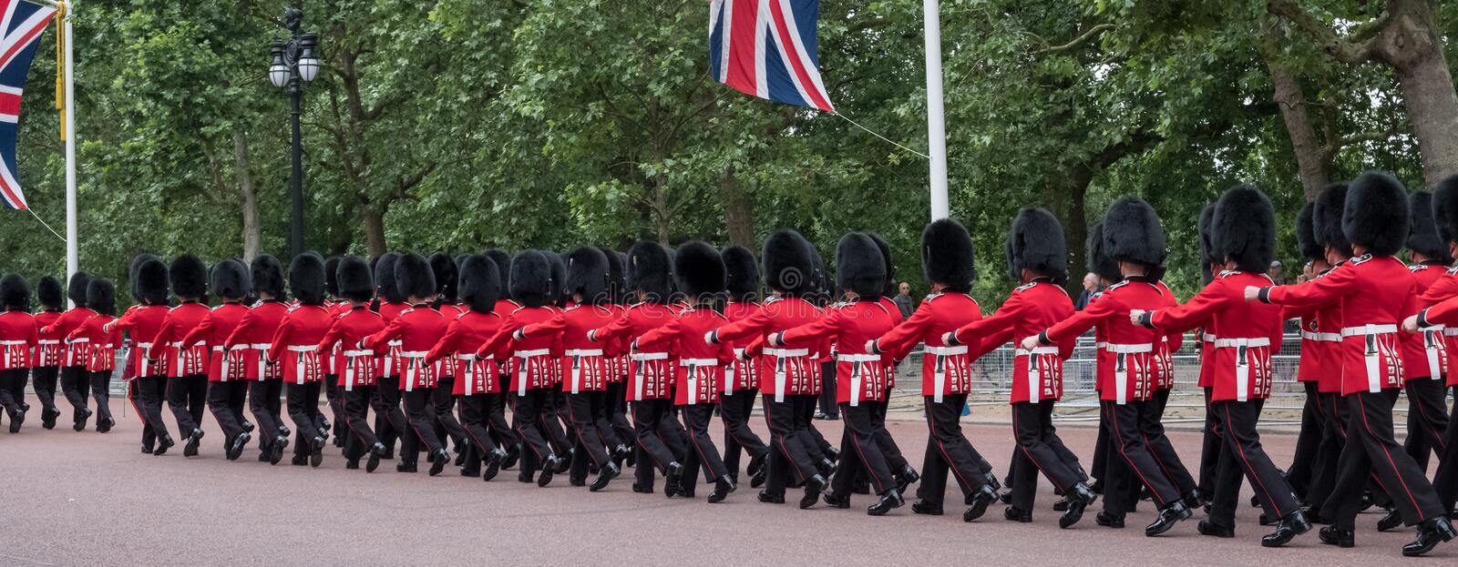 Soldiers marching down The Mall in London during the Trooping the Colour military ceremony, London. London UK. Soldiers with rifles and bayonets marching down stock image