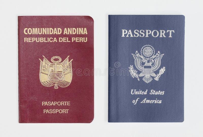 London / UK - 21st June 2019 - Peru and US passports, isolated on a white London / UK - 21st June 2019 - Peru and US passports,. London / UK - 21st June 2019 stock image