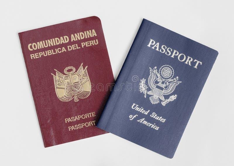 London / UK - 21st June 2019 - Peru and US passports, isolated on a white background. London / UK - 21st June 2019 - Peru and US passports, isolated on a white stock photo
