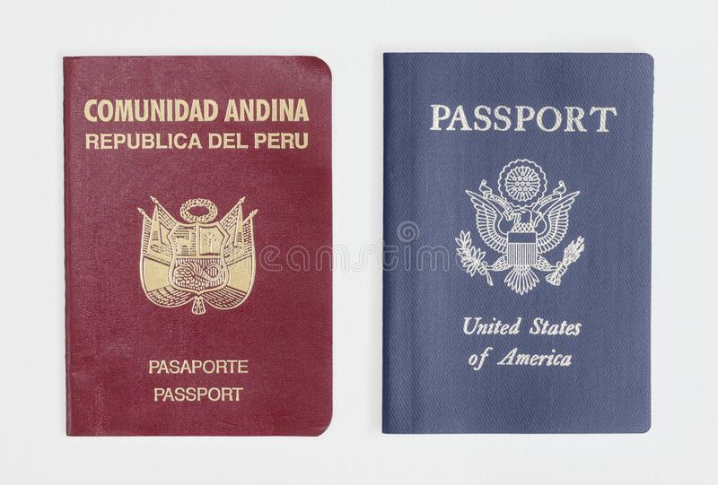 London / UK - 21st June 2019 - Peru and US passports, isolated on a white background.  royalty free stock photo