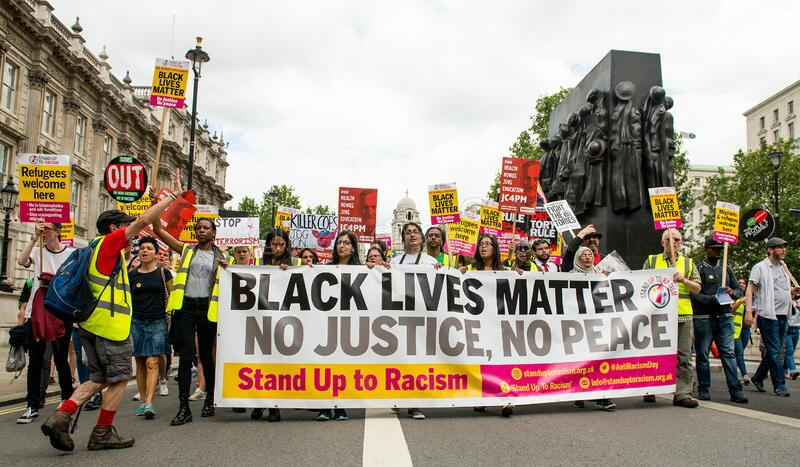 UK Black Lives Matter protest march through central London. London, UK. 16th July 2016. The lead banner at the Black Lives Matter / Stand Up To Racism protest royalty free stock photos