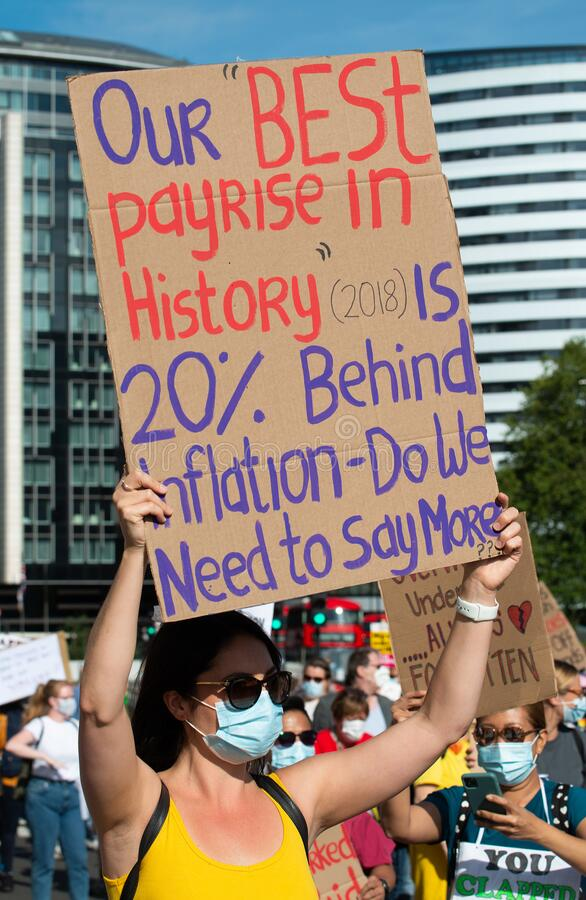 NHS workers protest, demanding a pay rise from the British Government. royalty free stock image