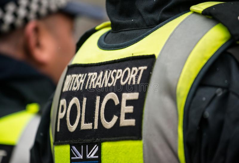 Close up of British Transport Police sign - London - United Kingdom. London, UK. 17th March 2018. EDITORIAL - Close up of badge on the back of police officer`s royalty free stock photography