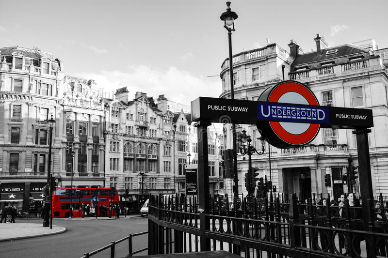 London Underground. A picture of a London underground train entrance, with a London Red bus in the background this will make a good travel/commuter theme royalty free stock photo