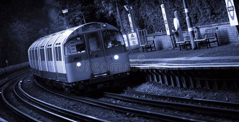 A London Underground Service heading to Uxbridge passing through Park Royal Station, London, UK - 5th September 2013. London Underground Service heading to royalty free stock photo