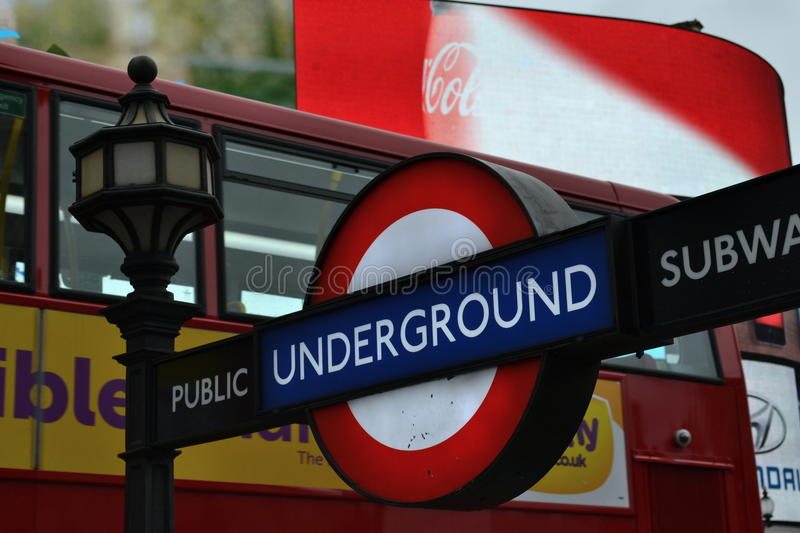 London underground sign red double decker bus stock image