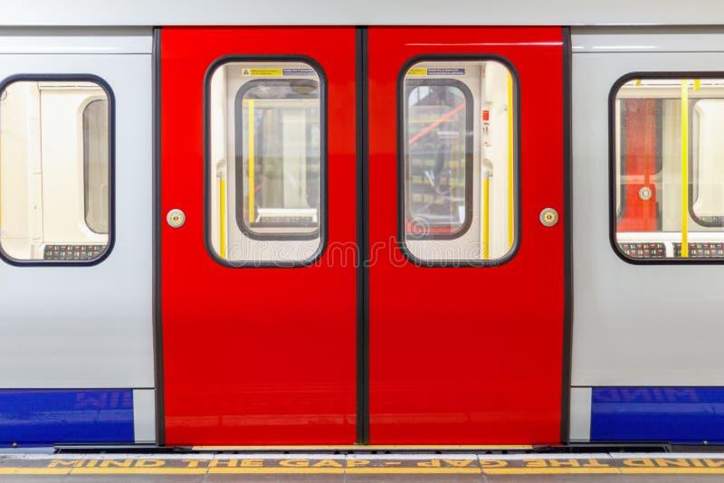 London underground train carriage waiting to depart. At platform stock image